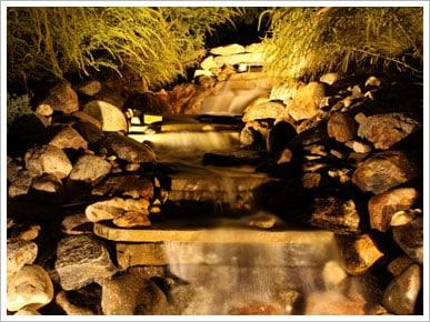 Lit up custom rock waterfall